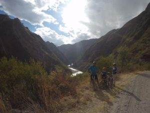 family package peru bike tour, on cliff side with river view