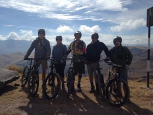 Happy bikers in Peru mountains on biking tour package