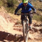bike tour cusco, biker on rocky mtb trail