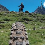 green grass and tire tread shot for peru biking tour