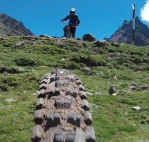 green grass and tire tread shot for peru biking tour
