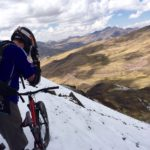 Gravity Peru Bike Team Member on snowy mountain bike trail in Cusco Peru