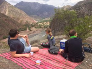 mountain biking tour cusco, eating lunch on scenic bike tour