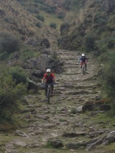 Inca Adventure with two bikers riding mountain bikes in cusco peru